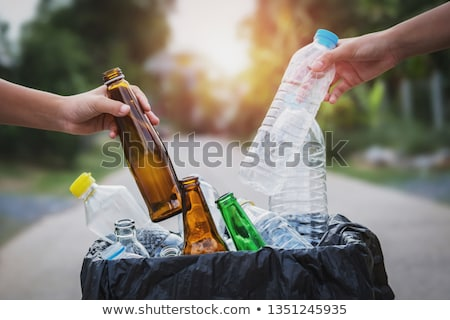 Cleaning up the Environment, Woman Collect Garbage Stock photo © robuart