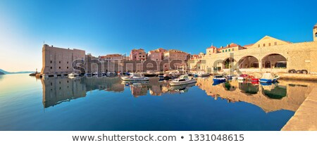 Dubrovnik harbor and city walls morning panoramic view Stock photo © xbrchx