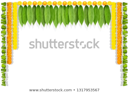 Mala indian flower garland for ugadi holiday. Floral mango leaves ornate decoration Stock photo © orensila