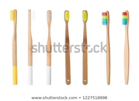 Arco-íris bambu escova de dentes cores branco corpo Foto stock © nito