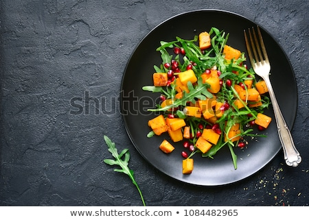 Delicious salad with arugula and baked pumpkin Stock photo © Melnyk