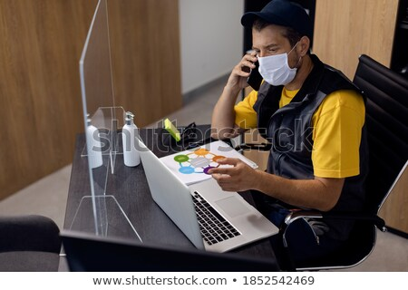 Stock photo: Gloves Protecting From Coronavirus While Using Laptop And Phone