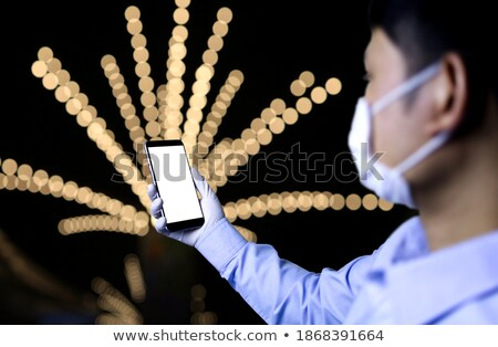 man wears mask and gloves, and text the new normal Stock photo © nito