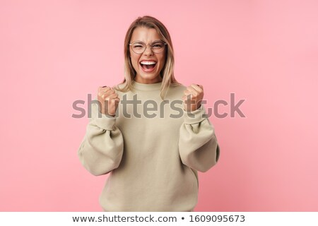 Portrait of delighted woman meditating and holding fingers together Stock photo © deandrobot