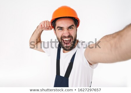 Man builder take selfie by camera showing biceps. Stock photo © deandrobot