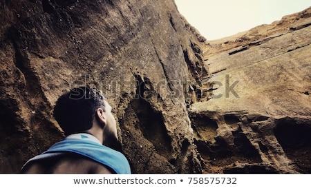 Kobieta patrząc na zewnątrz górskich jaskini dolinie Zdjęcia stock © lovleah