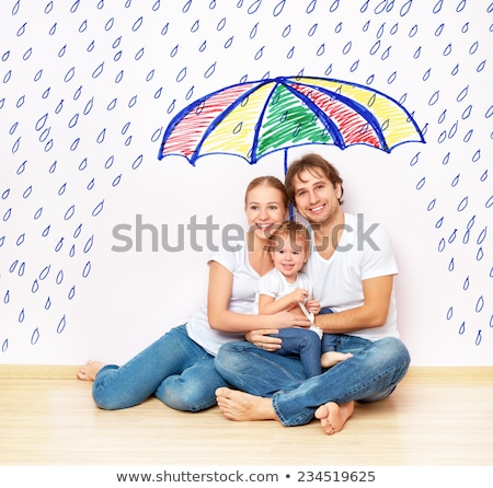 Silhouettes of family under umbrella cover Stock photo © Hermione