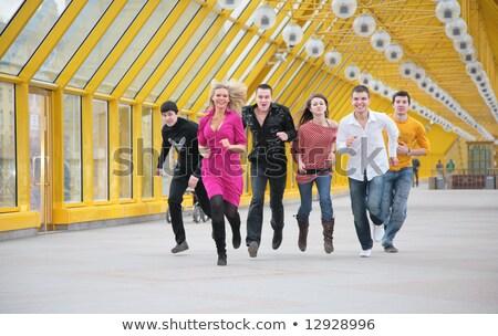 группа друзей пешеходный мост улыбка здании счастливым Сток-фото © Paha_L