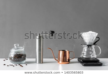 Kahve öğütücü cam fincan beyaz kahve çekirdekleri Stok fotoğraf © OleksandrO