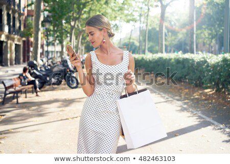 blonde girl with paper bags stock photo © photography33