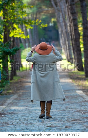 beautiful young elegant woman wearing hat outdoor at park she is stock photo © hasloo