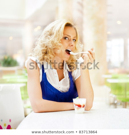 young woman enjoying coffee time at mall cafe eating ice cream stock photo © hasloo