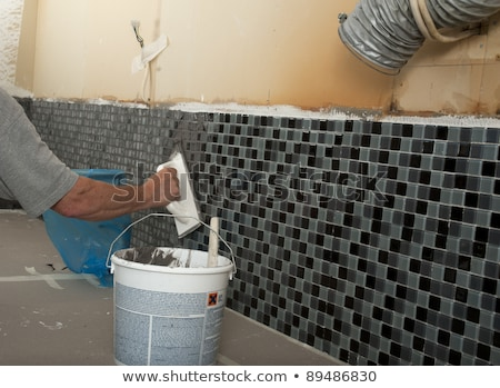 Melhoramento da casa mosaico trabalhando quebra-cabeça faca escove Foto stock © photography33