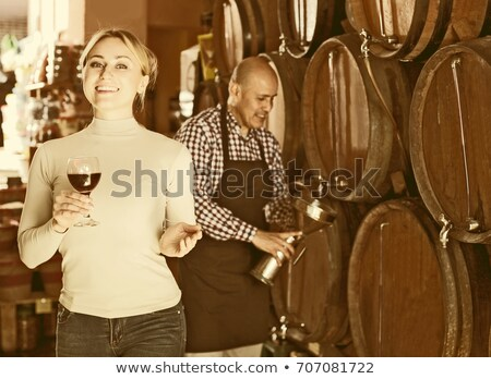 woman standing next to barrels of wine stock photo © photography33