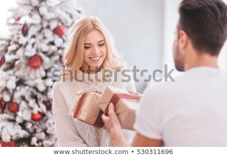 Couple exchanging Christmas gifts Stock photo © photography33