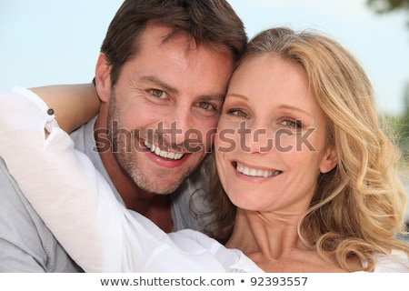 Couple stood with arms around each other Stock photo © photography33