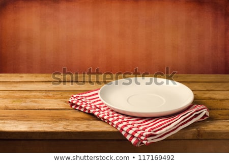 Empty white plate on tablecloth stock photo © artjazz
