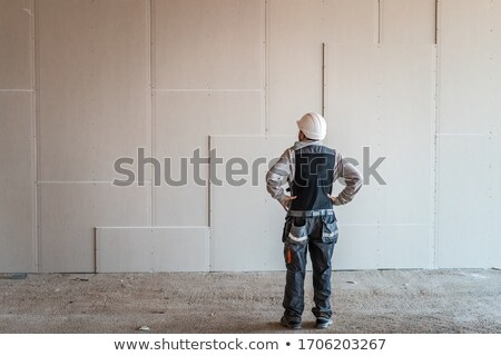 Builder proudly standing by wall Stock photo © photography33