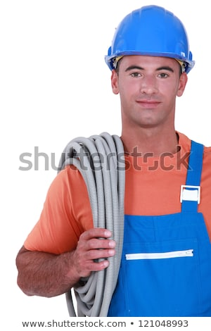 Tradesman carrying corrugated tubing around his shoulder Stock photo © photography33