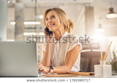smiling businesswoman on phone stock photo © christinerose81