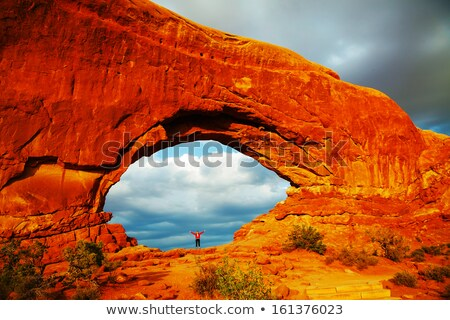 Woman staying with raised hands inside an Arch stock photo © AndreyKr