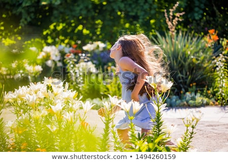Pretty young girl running in the park Stock photo © michey