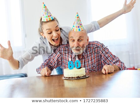 man blowing out birthday candle Stock photo © michey