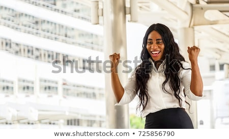 Excited businesswoman celebrating success Stock photo © stockyimages
