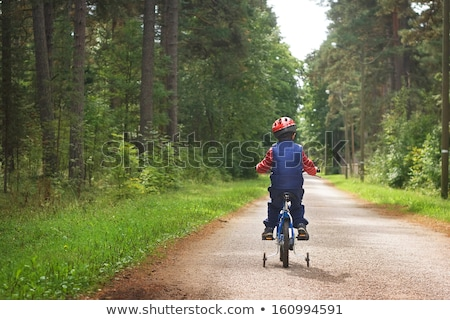 Little boy riding bike on country road outdoors Stock photo © pekour