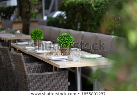 Stock photo: Served table in outdoor restaurant. Shallow depth of field.