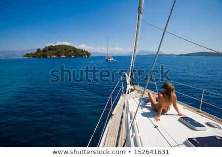 Fiatal nő vitorlázik luxus jacht napozás bikini Stock fotó © CandyboxPhoto