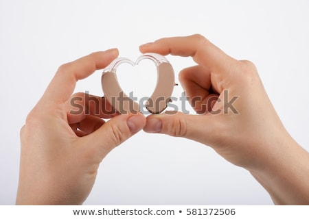 showing a heart from hearing aids stock photo © csontstock