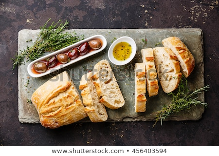 green olives with fresh bread and herbs stock photo © juniart