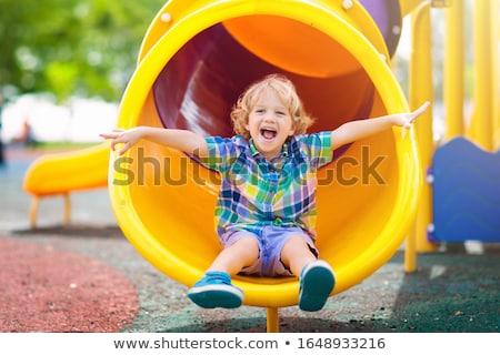 Küçük erkek oyun alanı zincir tişört yakışıklı Stok fotoğraf © pumujcl