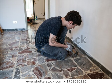 Mason using chisel on brick Stock photo © photography33