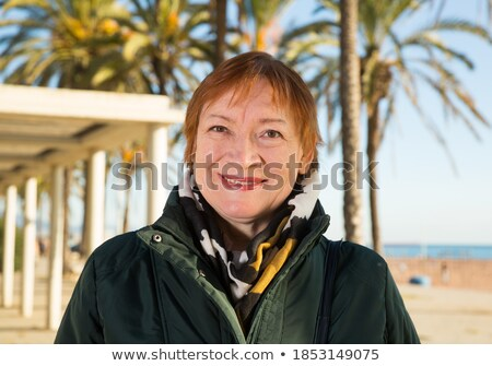 Woman walking along the quay on a sunny day Stock photo © photography33