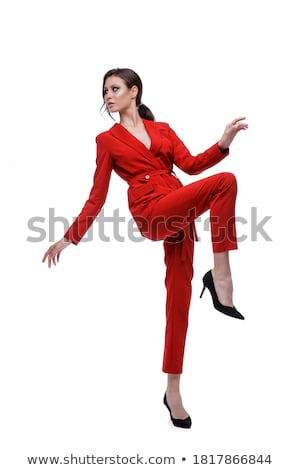 довольно · молодые · брюнетка · красный · костюм · изолированный - Сток-фото © acidgrey