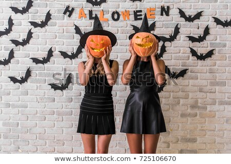 Stock photo: portrait of the young witch with scary pose