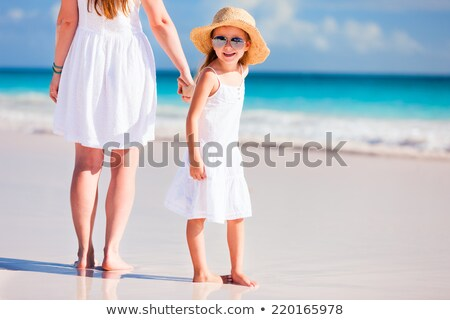 Adorable little girl at the beach with her mother Stock photo © wavebreak_media