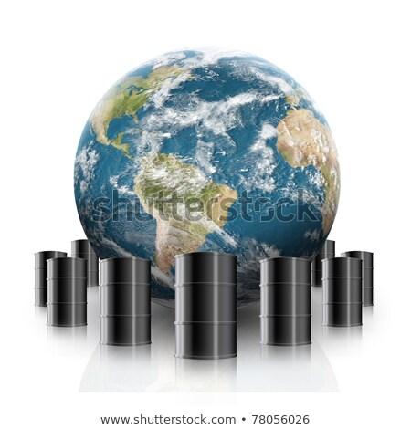 Globe Surrounded By Oil Barrels Stock photo © sdecoret