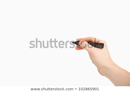 Fingers holding a black felt pen while pointing a blank space against a white background Stock photo © wavebreak_media