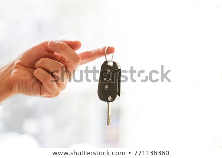 Mechanic giving car key to a man in a garage Stock photo © wavebreak_media