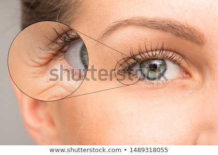 Woman apply anti wrinkle cream  Stock photo © Anna_Om