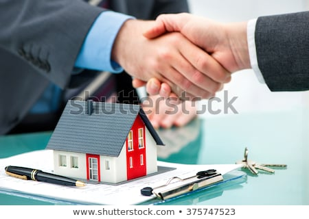 House in hands of businessman Stock photo © stevanovicigor