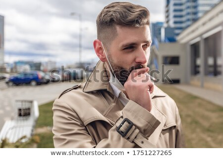 Smoking serious man after tiring job Stock photo © konradbak