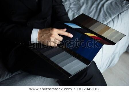 Választ öltöny jóképű fiatalember különleges alkalom vásárlás Stock fotó © luminastock