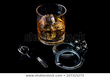 Shot glass with car keys and handcuffs Stock photo © Zerbor
