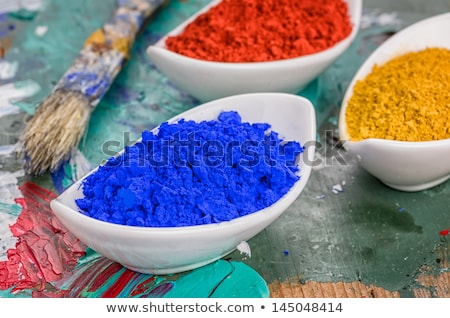 Vibrant color pigments in porcelain bowls on a wooden palette Stock photo © Zerbor