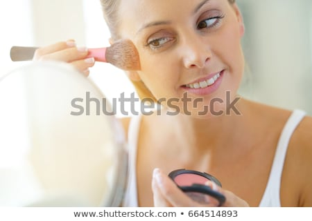 pretty woman with cosmetic brushes stock photo © nobilior