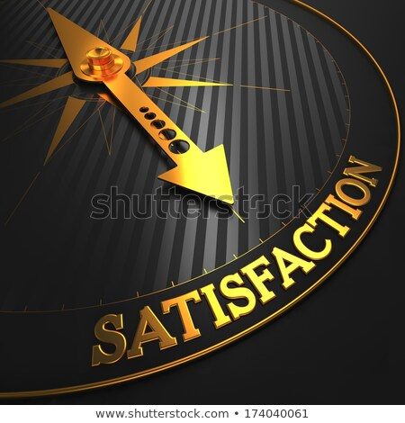Satisfaction on Black and Golden Compass. Stock photo © tashatuvango